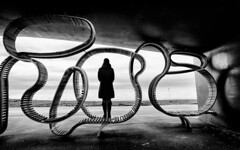 Fade to Black (markfly1) Tags: littlehampton seaside beach scene art sculpture street candid black white baw bw mono lone woman standing sea contrasts shadows light texture shapes curves lines nikon d750