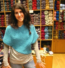 Irini is modeling her  new knitted  poncho (sifis) Tags: wool shop canon store model knitting knit merino athens yarn greece shawl poncho cardi handknitting αθήνα sakalak πλεκω μαλλια βελόνεσ σακαλάκ
