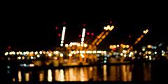 082. Ported (prenetic) Tags: seattle light red orange white water yellow night port dark lights bay washington streak bokeh crane dot cranes shore dots streaks portofseattle