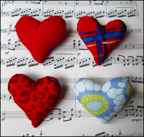 four vintage fabric heart brooches