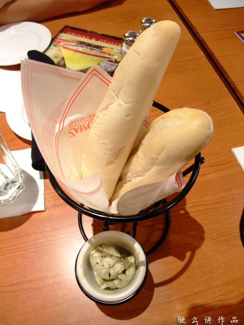 A complimentary breads with herbs butter