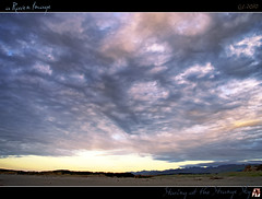 Staring at the Strange Sky (tomraven) Tags: sunset sky sun mountains beach strange clouds geotagged sand colours dunes driftwood hdr feb25 supershot fbdg geo:lat=40725665 tomraven aravenimage q12010 geo:lon=1751234