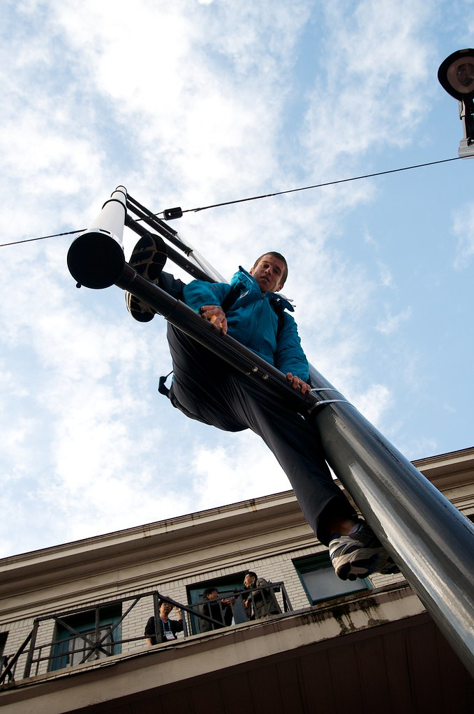 VANOC Volunteer Climbing Street Light