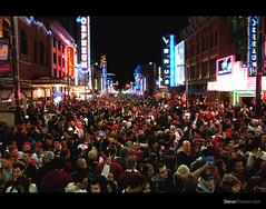 United In Celebration (Steve Rosset) Tags: street city winter red sea party wild people urban canada west sign retail youth night vancouver buildings geotagged gold evening coast crazy downtown neon bc view outdoor granville britishcolumbia united crowd perspective atmosphere patriotic games flags aerial tagged celebration busy rush signage alive olympics closing patriotism geo loud streetscape crowds packed masses 2010 ceremonies flooded fanmeile steverosset tgamgamescelebration steverossetphotography