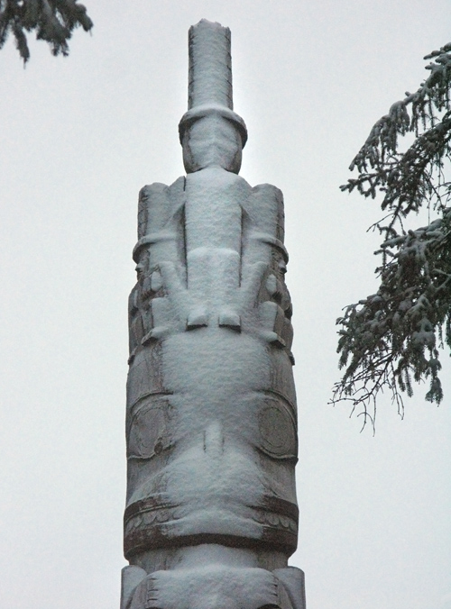 snow on the top of a totem pole, Kasaan Totem Park, Kasaan, Alaska