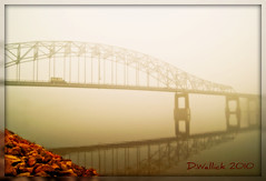 Foggy Solitude (Doug Wallick) Tags: bridge reflection minnesota fog truck river mississippi rocks foggy hastings picnik lightroom a230 us61 abigfave