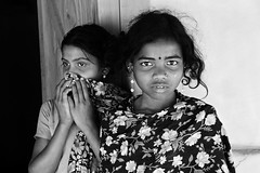 Eyes of uncertain future... (- Ariful H Bhuiyan -) Tags: girls two bw eye face kids rural village faces expression human pear ttl childs colorless bangladesh bangladeshi bangali proverty majorityworld monocrom ttlsafari gettyimagesbangladeshq2