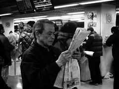 The Listings (joyjwaller) Tags: portrait blackandwhite face japan tokyo concentration newspaper intense oldman read horseraces tokyodome listings japaneseman offthecuff seedyatmosphere