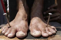 Nailing feet to Cross