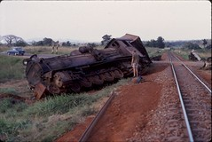 Derailed train near Morogoro, Tanzania (ronmcbride66) Tags: train tanzania rust fiat crash accident ear locomotive headlight gauge railwaytrack steamengine derailed steamtrain baobab levelcrossing derailment morogoro traincrash supershot eastafricanrailways offtherails coth5 lasttrainto