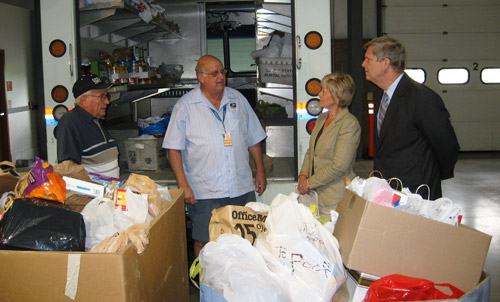 The Secretary visits a food bank in Pittsburgh, where local postal workers have delivered donated food.