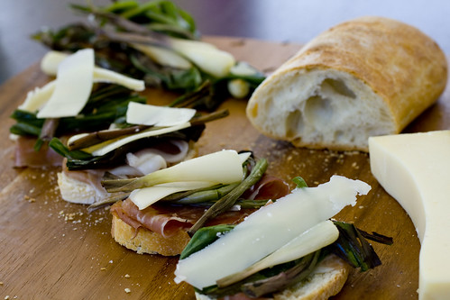 Prosciutto, ramps, and gruyere on wood board 7