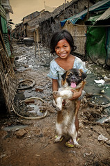 Andong Village, Cambodia needs your help urgently! (Mio Cade) Tags: dog water girl rain kid garbage cambodia village child flood abraham drain help aid monsoon donation waste phnom ngo penh drainage chap casualty resident funds sewerage sambok andong