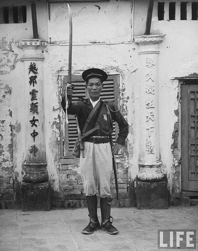 1948 - French Indo China Tran Dang Man lifting his sword in token of shift of allegiance to French.