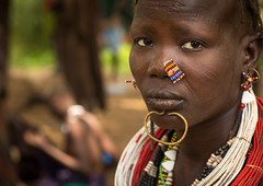Portrait of a sudanese Toposa tribe woman refugee with nose decoration and scarifications, Omo Valley, Kangate, Ethiopia (Eric Lafforgue) Tags: adult africa anthropology beaded beads beautifulpeople bizarre blackpeople bodytransformation chin closeup day decoration developingcountry eastafrica ethiopia ethiopia0617284 ethiopian feminine headshot horizontal hornofafrica indigenousculture jewel jewelry kangate labret lookingatcamera necklaces omovalley oneperson onewomanonly outdoors portrait refugee scarifications scars sudanese toposa traditionalclothing tribal tribe tribeswoman women et