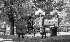 No One To Play With (John Kocijanski) Tags: bench picnictable people candid playground park blackandwhite canong15 hbm