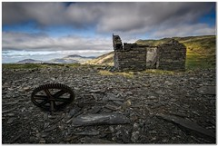 The slate quarry ruins (Hugh Stanton) Tags: wheel outhouse slate ruin appicoftheweek