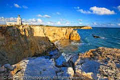 View of the Los Morillos Lighthouse, Cabo Rojo, Puerto Rico (George Oze) Tags: ocean travel sunset lighthouse horizontal landscape island colorful puertorico shoreline scenic nobody cliffs historic tropical caribbean colourful caborojo caribbeansea spanisharchitecture limestonecliffs ruggedcoastline losmorilloslighthouse puntamorillos caborojonationalwildliferefuge pointmorillos