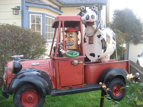 A man and his dog and his cow in his truck