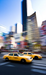 rush in time square (Mr Din) Tags: street nyc newyorkcity blue ny newyork motion blur building colors yellow buildings square long time pov manhattan cab wideangle blurred motionblur timesquare walkway neat cabs panning 2009 types exp longexp superaplus aplusphoto fli