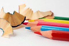 Several crayons on a white paper (Horia Varlan) Tags: blue red green yellow pencils wooden colored shrapnel