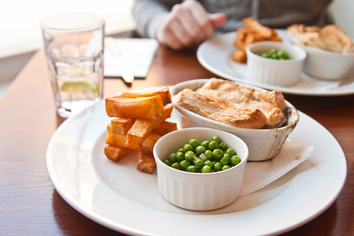 Steak and Guiness pie with peas and chips