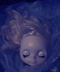 she's dead. wrapped in plastic