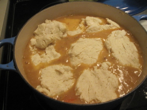 Adding dumplings to the chicken stew