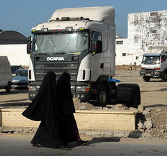 TRUCKING IN TANGIERS (Claude  BARUTEL) Tags: africa woman port truck boat veiled harbour muslim morocco containers scania tangiers