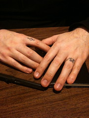 tattoo on two fingers