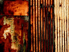 Rust (robertvena) Tags: orange brown white abstract black colors metal rust colorful steel cream sheets designs weathered siding corrugated