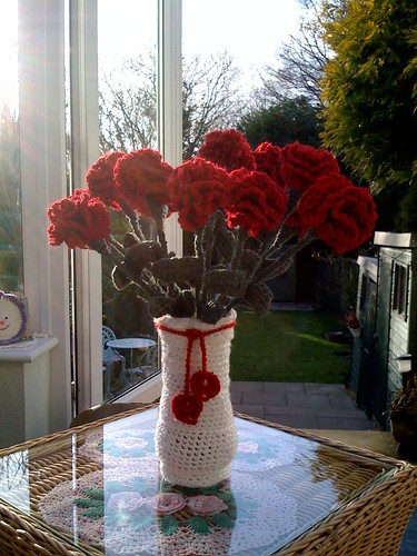 Crocheted Carnations and Crocheted Vase Cover with dangly hearts for the people in my life