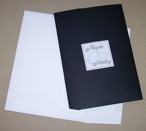 A black pocket folder with red ribbon-2