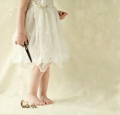 a little bit mischievous (Svetlana Bekyarova / freesoul) Tags: texture kid scissors getty littlefeet whitedress cuthair gettyonsale