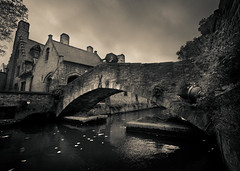 Singing in the rain (markpaulandrews) Tags: bridge winter cloud white black sepia geotagged canal belgium brugge stevens medieval louise bruges bel 2009 flanders louisestevens geo:lat=5120493405 geo:lon=322525710