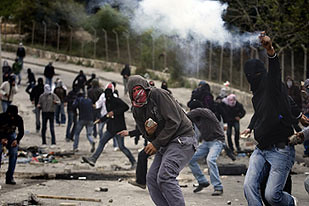 Palestinian youth resist the Israeli military in East Jerusalem. The Zionist regime has maintained its settler-colonial state with the backing of U.S. imperialism. by Pan-African News Wire File Photos