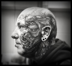 Tattoo Artist Ralf (_MissAgentCooper) Tags: tattoo artist noiretblanc head piercing convention sw damon tatu daemon 2010 vaduz kopf tattoed dmon httpwwwfreibeutertattooch