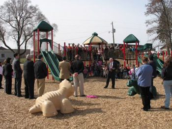 State Director for Michigan James Turner speaks before the new playground at Walkerville