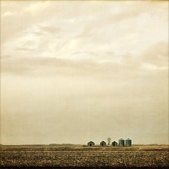 . grain bins and sheds . (susanonline (busy these days)) Tags: sunset field clouds evening spring manitoba textures prairie sheds stubble grainbins itg flypapertextures susanonline