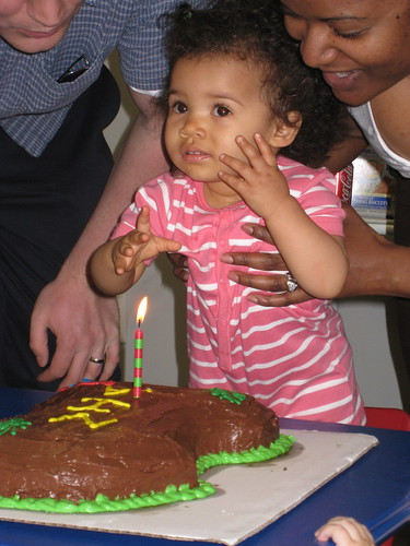 Nia blowing out her candle