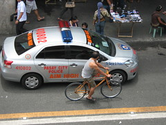 POLICE CAR VERSUS THE BICYCLE (PINOY PHOTOGRAPHER) Tags: world trip travel canon asia tour image philippines picture filipino pasay pilipinas luzon metromanila