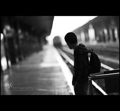 2046 (ttuelam) Tags: lighting light boy blackandwhite bw white black train canon raw dof bokeh tracks hbw nicoinrome nicodepasquale wwwnicodepasqualecom