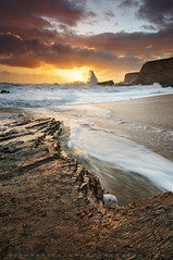 The Draw - Panther Beach, Davenport, California (Jim Patterson Photography) Tags: ocean california travel light sunset red sea portrait sky usa santacruz sun seascape storm motion color reflection beach nature water vertical clouds landscape golden coast sand marine rocks colorful waves natural pacific cove tripod salt shoreline scenic dramatic rocky wideangle stormy highway1 coastal shore coastline ripples bluffs davenport gitzo reallyrightstuff pacificcoasthighway pantherbeach remoterelease nikkor1224mm singhray frhwofavs nikond300 markinsm20ballhead jimpattersonphotography jimpattersonphotographycom darylbensonreversegrad seatosummitworkshops seatosummitworkshopscom
