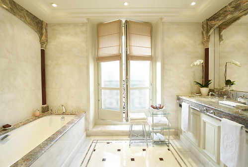 elegant bathroom lighting, Majestic and magnificent bathroom of an Executive Room at the Hotel de Crillon, Paris, France