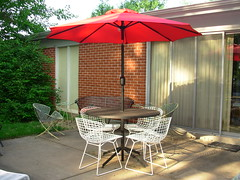 Bertoia Side Chairs, Unkown Table & Red Umbrella