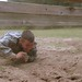 Spc. Ronald Larson Climbs Under Obstacle