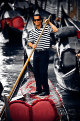 The Gondolier (***Alex Photography***) Tags: street new city trip travel family blue venice friends light shadow summer portrait people italy sun eye art alex colors smile face hat festival wall shirt digital work canon dark hair photography boot eos dawn design early photo spring cool nice italian europe graphic skin photos good live illustrations style gondola venezia gondolier adria creations veneto mywinners anawesomeshot alexphotography