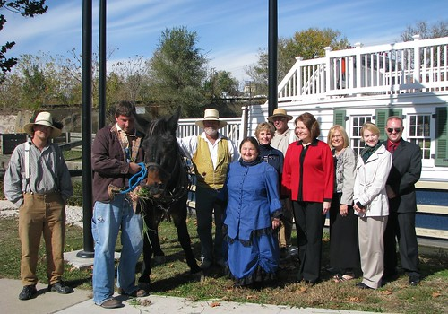 Costumed guides, along with Larry the mule, were part of the tour of the Canal Corridor Association's mule-pulled canal boat.  Tour participants from right to left are Centrue Bank Vice President Doug Patterson; Samantha Warren, regional director for Rep. Debbie Halvorson; Canal Corridor Association President Ana Koval; Business and Cooperative Programs Administrator Judith Canales, and Illinois State Director Colleen Callahan.