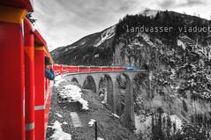 Toni's Adventures in the monochrome Wonderland (Toni_V) Tags: red snow mountains alps train schweiz switzerland europe suisse perspective zug unesco 2009 unescoworldheritage hdr rhb d300 sigma1020mm colorkey graubnden unescowelterbe zugfahren photomatix landwasserviadukt filisur hdrsingleraw selectivecolors capturenx toniv wwwrhbch rthischebahn churstmoritz dsc6646 theperfectphotographer toniv photoshop