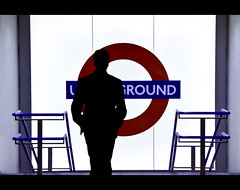 Mind the Gap (Eljor Kerciku Portfolio) Tags: life new eve red man black london colors silhouette architecture night way underground walking shot britain year great tube exit 1785 rosso londra nero contrasts architettura capodanno controluce 2010 inghilterra 50d mywinners